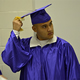 An offender at the Polunsky Unit prepares for graduation after earning his GED through the Windham School District.